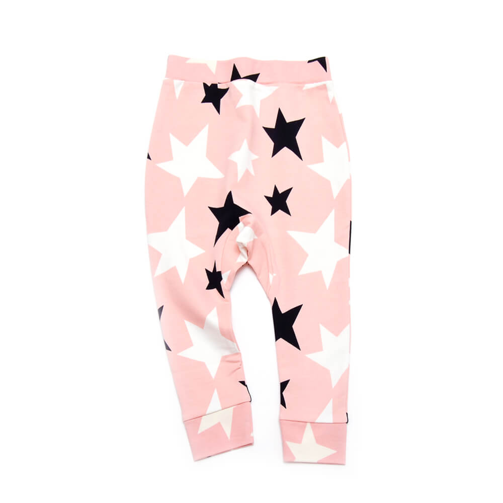 front of rose sweatpants for girls with black and white stars made of organic cotton