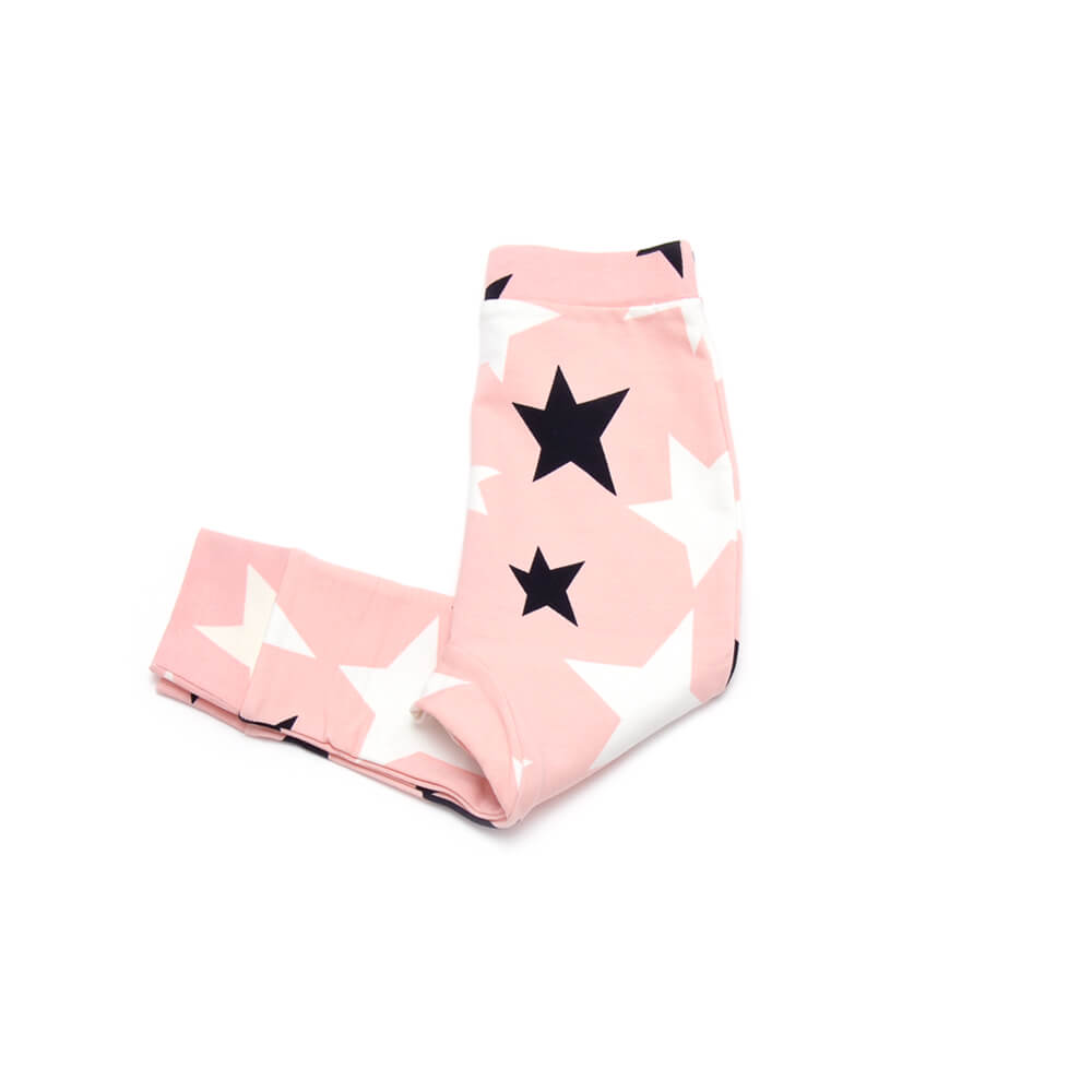 sideviwe of rose sweatpants for girls with black and white stars made of organic cotton