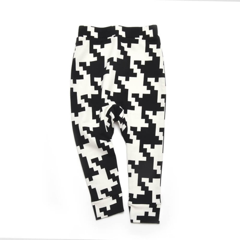 front side of unisex black and white sweatpants made of organic cotton