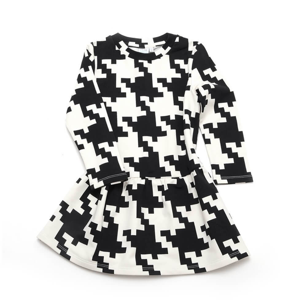 front side of girls black and white dress made of organic cotton