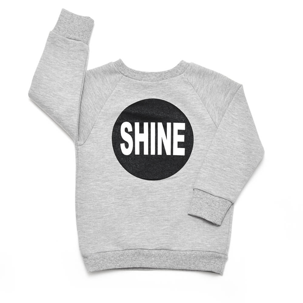 grey sweater for girls with black silkscreen print on front and back made of organic cotton
