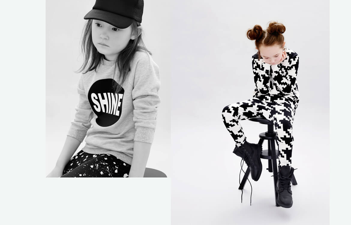 unisex kids fashion - grey girls sweater with silkscreen print and black and white unisex leggings with love from Berlin