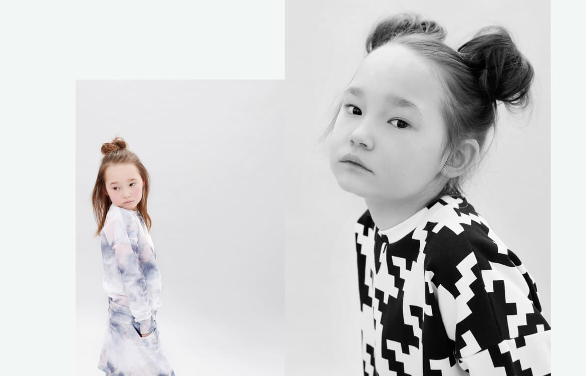 organic kids apparel - blue and white girls dress and black and white unisex sweater with love from Berlin