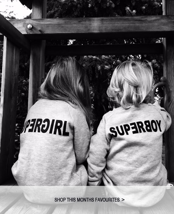 organic kids fashion - black and grey SUPERBOY sweater and SUPERGIRL sweater made of organic cotton in Berlin