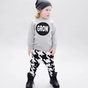 frontside of grey boys sweater and black and white unisex sweatpants made of organic cotton