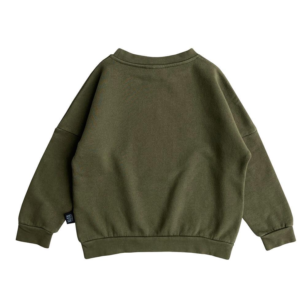 green skull sweater back